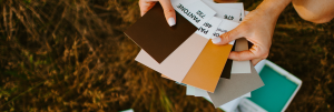 hand holding pantone color samples
